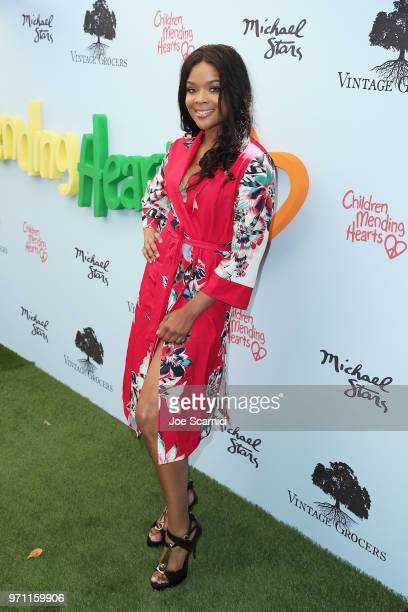 Ajiona Alexus attends the Children Mending Hearts' 10th Annual Empathy Rocks Fundraiser at Private Residence on June 10 2018 in Bel Air California