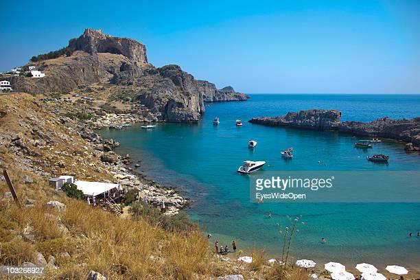 Ajios Pavlos the old harbour and most beautiful bay of the town of Lindos on July 04 2010 in Lindos Greece The old town of Lindos is famous for its...