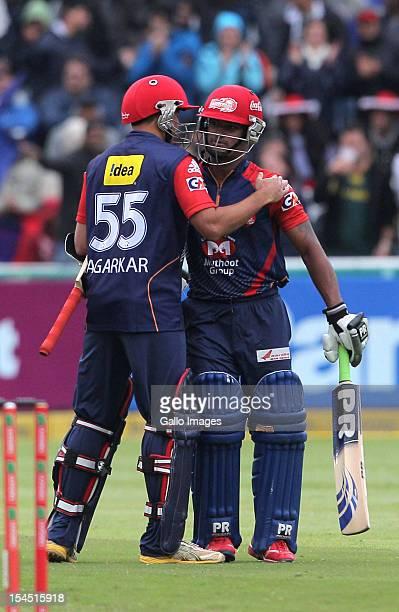 Ajit Agarkar and Pawan Negi of the Delhi Daredevils celebrate victory during the Champions league twenty20 match between Perth Scorchers and Delhi...