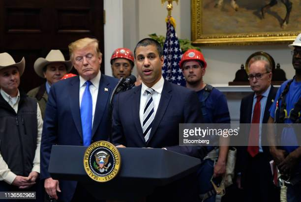 Ajit Pai, chairman of the Federal Communications Commission , center, speaks during an event on developing 5G Infrastructure with U.S. President...