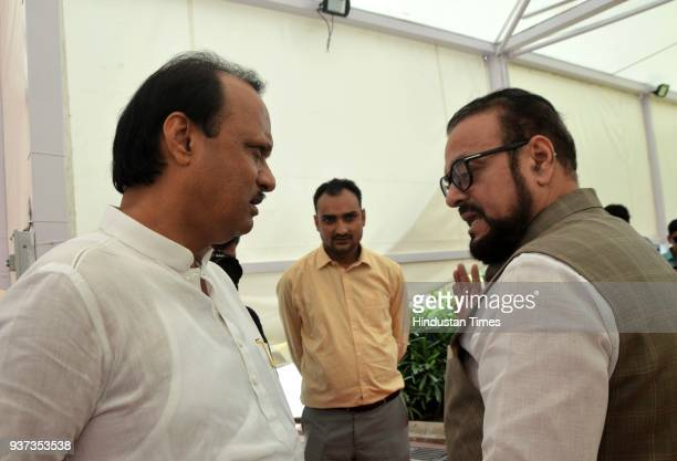 Ajit Pawar interacts with Abu Asim Azmi during the budget session at Vidhan Bhavan on March 23 2018 in Mumbai India