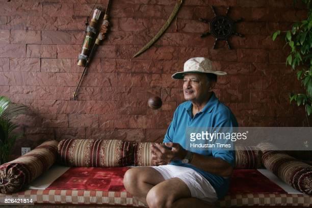 Ajit Wadekar tossing a season ball at his home in Worli
