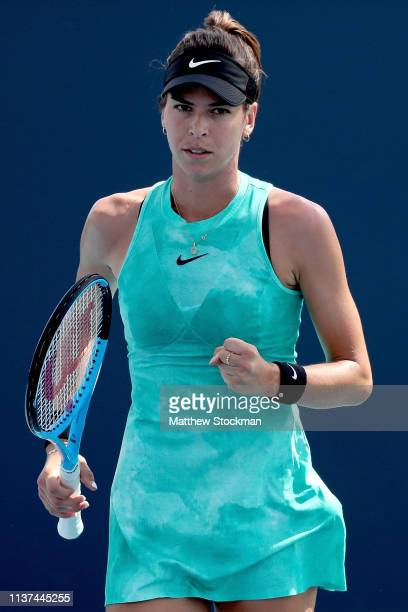 Ajla Tomlijanovic of Australia celebrates a point while playing AnnaLena Friedsam of Germany during the Miami Open Presented by Itau at Hard Rock...