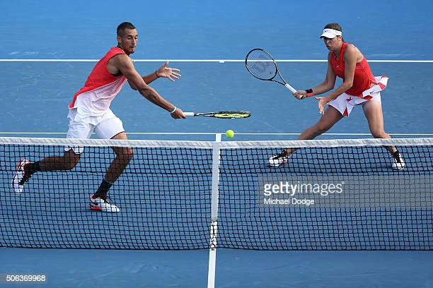 Ajla Tomljanovic and Nick Kyrgios of Australia during their first round mixed doubles match against Sania Mirza of India and Ivan Dodig of Croatia...