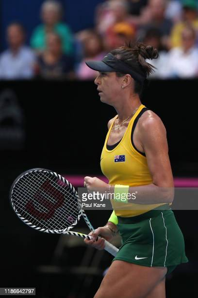 Ajla Tomljanovic of Australia celebrates winning a game during the match against Pauline Parmentier of France in the 2019 Fed Cup Final tie between...
