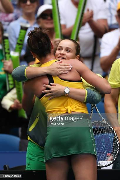 Ajla Tomljanovic of Australia embraces Ash Barty after winning the match against Pauline Parmentier of France in the 2019 Fed Cup Final tie between...