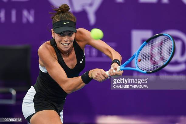 Ajla Tomljanovic of Australia hits a retun against Tamara Zidansek of Slovakia during their semifinal match at the Thailand Open tennis tournament in...