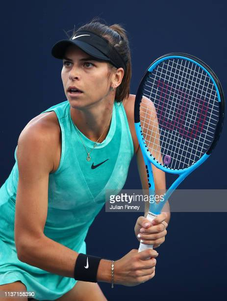 Ajla Tomljanovic of Australia in action against AnnaLena Friedsam of Germnay during day three of the Miami Open tennis on March 20 2019 in Miami...