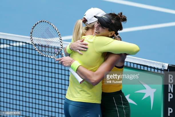 Ajla Tomljanovic of Australia is embraced by Alicia Molik after winning the set against Pauline Parmenntier of France during the match in the 2019...