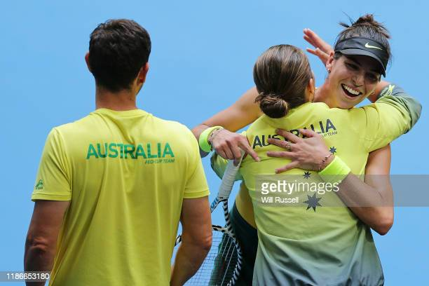 Ajla Tomljanovic of Australia is embraced by Ash Barty after winning the set against Pauline Parmenntier of France during the match in the 2019 Fed...