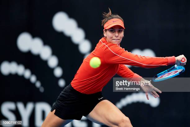 Ajla Tomljanovic of Australia plays a backhand shot against Camila Giorgi of Italy during day two of the 2019 Sydney International at Sydney Olympic...