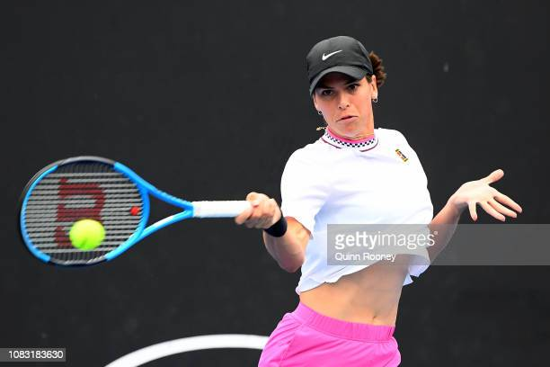 Ajla Tomljanovic of Australia plays a forehand in her first round doubles match with Magda Linette of Poland against Alize Cornet of France and Petra...