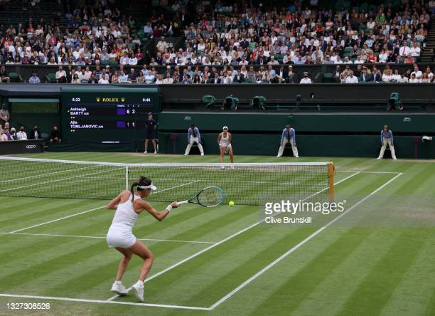 Ajla Tomljanovic of Australia plays a forehand in her Ladies' Singles Quarter-Final match against Ashleigh Barty of Australia during Day Eight of The...