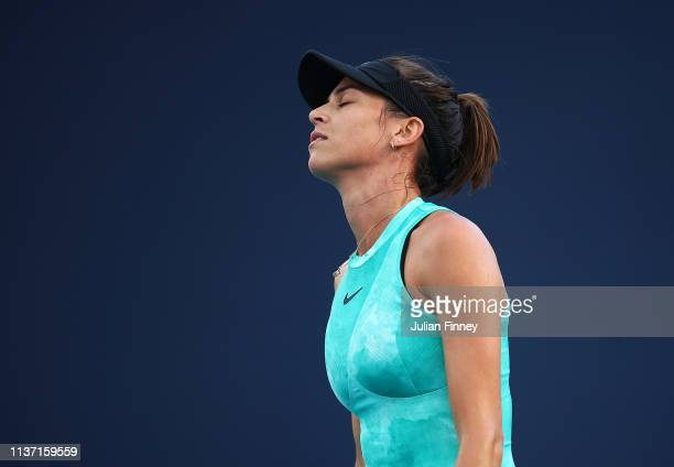 Ajla Tomljanovic of Australia reacts against AnnaLena Friedsam of Germany during day three of the Miami Open tennis on March 20 2019 in Miami Gardens...