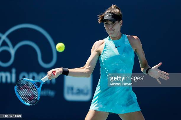 Ajla Tomljanovic of Australia returns a shot against Aryna Sabalenka of Belarus during Day 5 of the Miami Open Presented by Itau at Hard Rock Stadium...