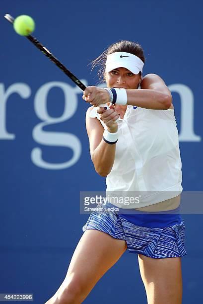 Ajla Tomljanovic of Australia returns a shot against Carla Suarez Navarro of Spain on Day Two of the 2014 US Open at the USTA Billie Jean King...