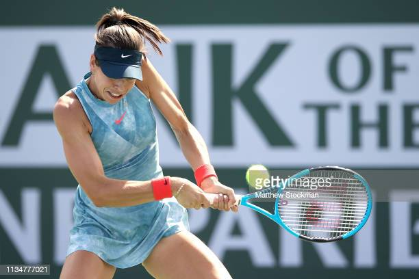 Ajla Tomljanovic of Australia returns a shot to Aryna Sabalenka of Belarus during the BNP Paribas Open at the Indian Wells Tennis Garden on March 09...
