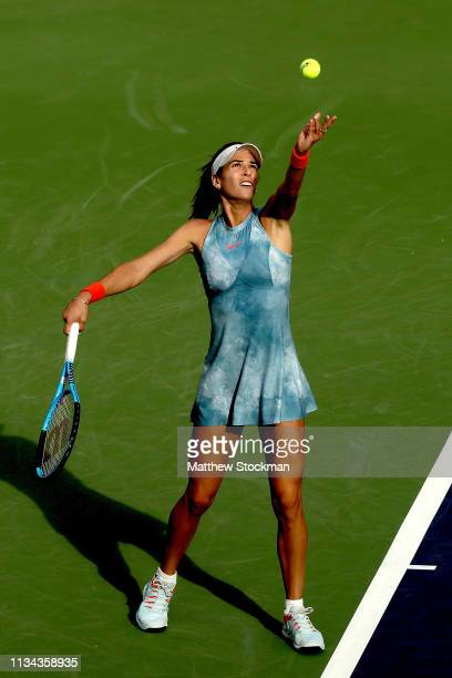 Ajla Tomljanovic of Australia serves to Alize Cornet of France during the BNP Paribas Open at the Indian Wells Tennis Garden on March 07 2019 in...