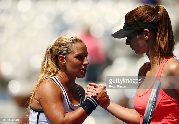 Ajla Tomljanovic of Australia shakes hands with Dominika Cibulkova of Slovakia after her second round match during day four of the 2015 Australian...
