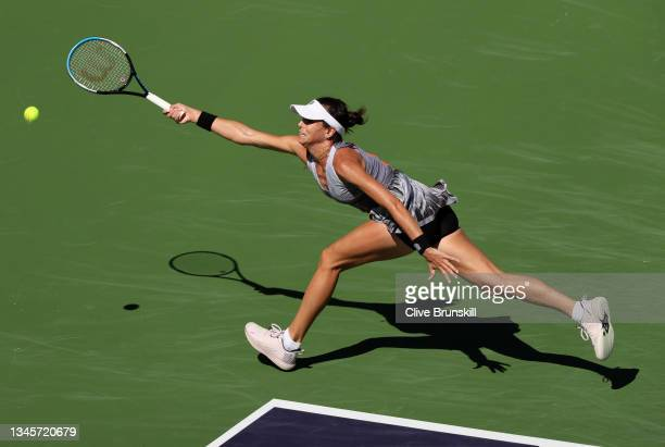 Ajla Tomljanovic of Australia stretches to play a forehand against Garbine Muguruza of Spain during their second round match on Day 6 of the BNP...