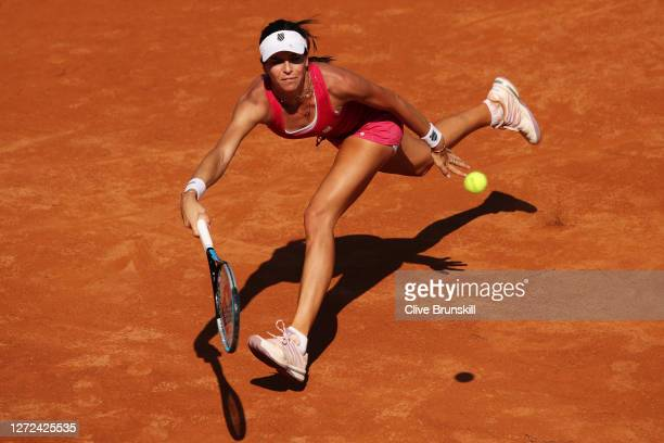 Ajla Tomljanovic of Australia stretches to play a forehand in her round one match against Marie Bouzkova of the Czech Republic during day one of the...