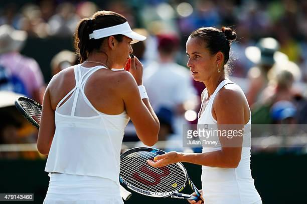 Ajla Tomljanovic of Australia talks tactics with Jarmila Gajdosova of Australia in their Ladies Doubles First Round match against YungJan Chan of...