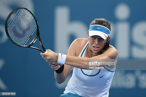 Ajla Tomljanovic of Coratia plays a backhand against Carla Suarez Navarro of Spain during day two of the 2016 Brisbane International at Pat Rafter...