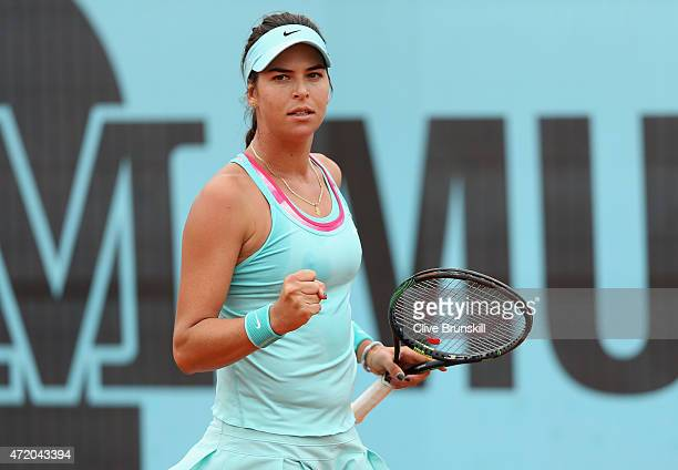 Ajla Tomljanovic of Croatia celebrates a point against Belinda Bencic of Switzerland in their first round match during day two of the Mutua Madrid...
