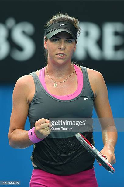 Ajla Tomljanovic of Croatia celebrates a point in her second round match against Sloane Stephens of the United States during day four of the 2014...
