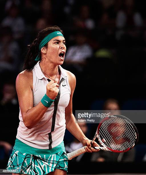 Ajla Tomljanovic of Croatia celebrates victory in her first round match against Mona Barthel of Germany on day one of the Porsche Tennis Grand Prix...