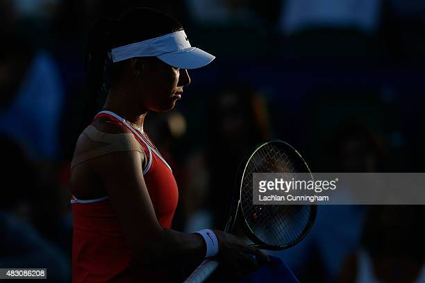 Ajla Tomljanovic of Croatia changes ends during her match against Madison Keys of the United States during day three of the Bank of the West Classic...