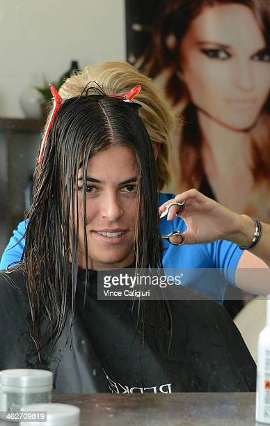 Ajla Tomljanovic of Croatia getting her hair done at the Player Beauty Bar during day 3 of the 2014 Australian Open at Melbourne Park on January 15...