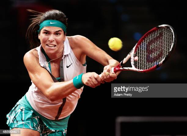 Ajla Tomljanovic of Croatia hits a backhand during her first round match against Mona Barthel of Germany on day one of the Porsche Tennis Grand Prix...