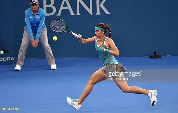 Ajla Tomljanovic of Croatia hits a return against Jelena Jankovic Serbia on day one of the Brisbane International tennis tournament in Brisbane on...
