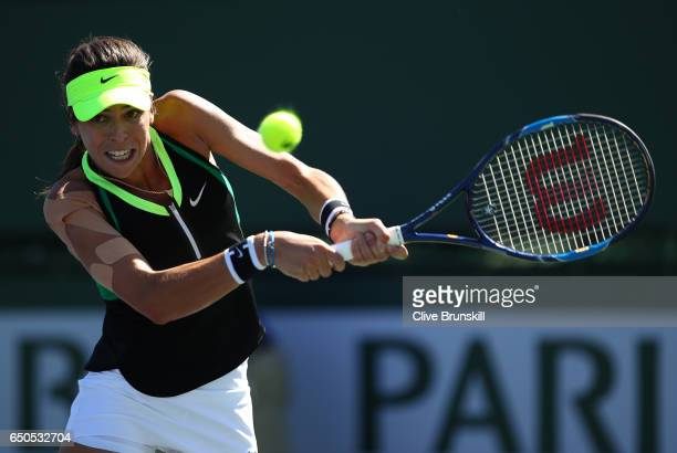 Ajla Tomljanovic of Croatia plays a backhand against Julia Goerges of Germany in their first round match during day four of the BNP Paribas Open at...