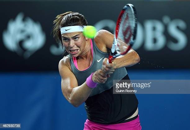 Ajla Tomljanovic of Croatia plays a backhand in her second round match against Sloane Stephens of the United States during day four of the 2014...