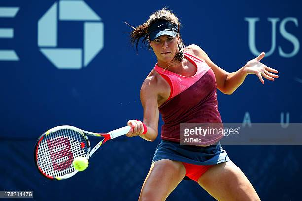 Ajla Tomljanovic of Croatia returns a shot during her women's singles first round match against Casey Dellacqua of Australia on Day Two of the 2013...