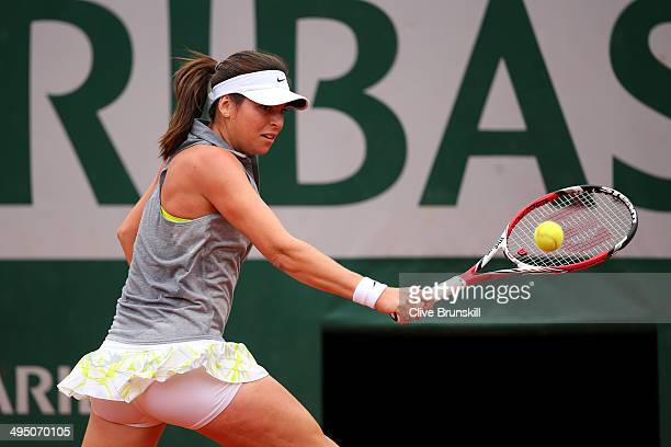 Ajla Tomljanovic of Croatia returns a shot in her women's singles match against Carla Suarez Navarro of Spain on day eight of the French Open at...