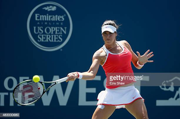 Ajla Tomljanovic of Croatia returns a shot to Karolina Pliskova of the Czech Republic during Day 5 of the Bank of the West Classic at Stanford...
