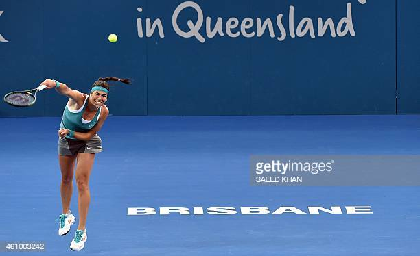 Ajla Tomljanovic of Croatia serves against Jelena Jankovic Serbia on day one of the Brisbane International tennis tournament in Brisbane on January 4...