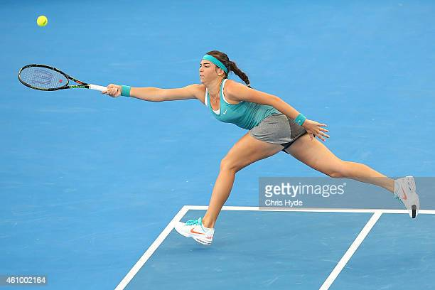 Ajla Tomljanovic of Croatia stretches for a forehand in her match against Jelena Jankovic of Serbia during day one of the 2015 Brisbane International...