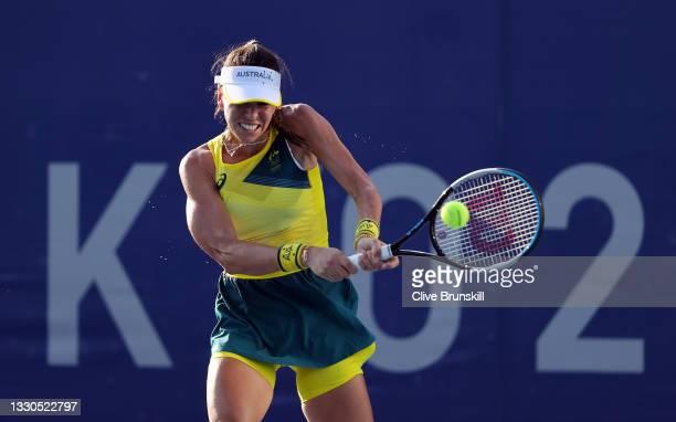 Ajla Tomljanovic of Team Australia plays a backhand during her Women's Singles First Round match against Yaroslava Shvedova of Team Kazakhstan on day...
