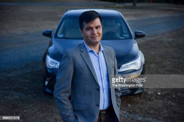 Ajmal 'AJ' Faqiri stands for a portrait outside his car on Tuesday December 19 in Reston VA AJ is a former interpreter for US troops in Afghanistan...
