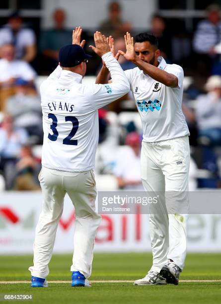 Ajmal Shahzad of Sussex celebraates with teammates after claiming the wicket of Joe Denly of Kent during day one of the Specsavers County...