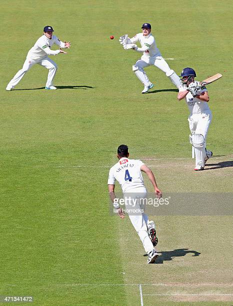 Ajmal Shahzad of Sussex celebrates the wicket of Calum MacLeod of Durham during day 2 of the LV County Championship match between Durham CCC and...