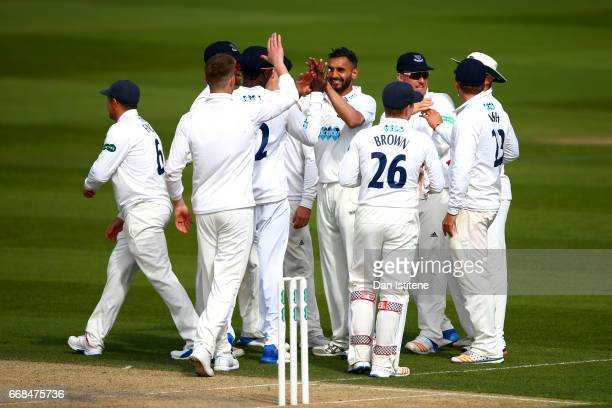 Ajmal Shahzad of Sussex celebrates with teammates after claiming the wicket of Sam Northeast of Kent during day one of the Specsavers County...