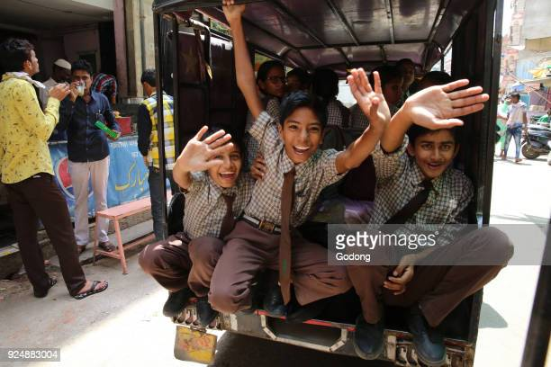 Ajmer schoolboys waving from a vehicle India
