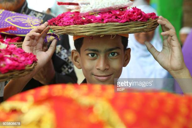 Ajmer Sharif dargah Rajasthan Boy carrying offerings India