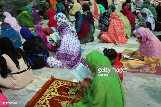 Ajmer Sharif dargah Rajasthan Women reading koranic scriptures India
