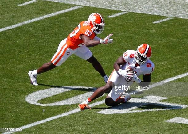 Ajou Ajou of the Clemson Tigers makes a reception as Andrew Booth Jr. #23 defends during the Clemson Orange and White Spring Game at Memorial Stadium...